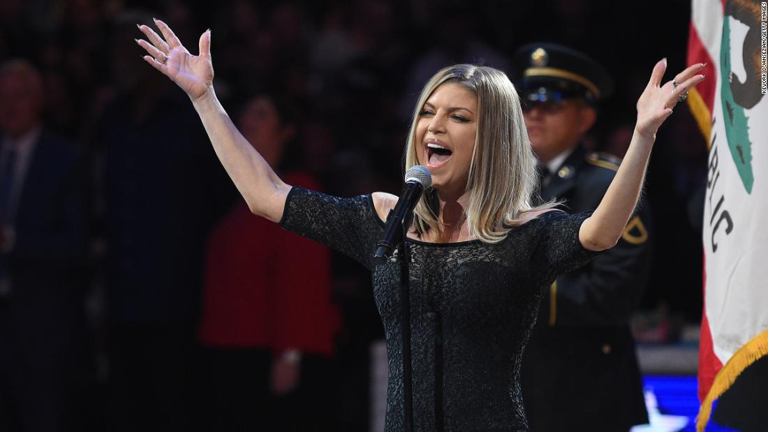 Fergie sings the National Anthem before the game.
