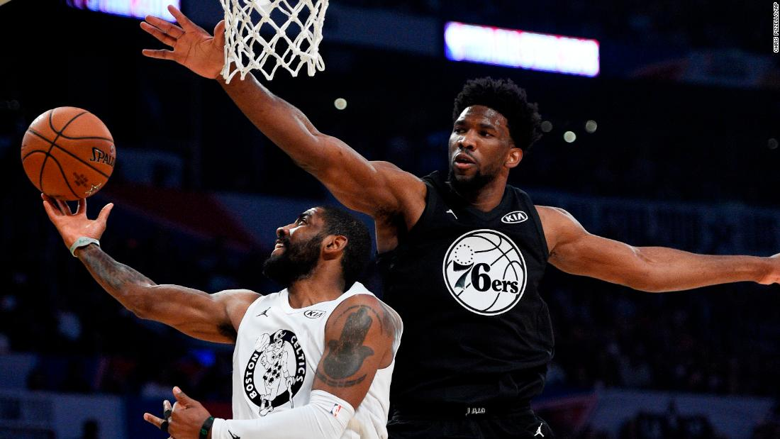 Irving, playing for Team LeBron, is defended by Joel Embiid during the first half. It was the first time Irving played with James since being traded by the Cleveland Cavaliers.
