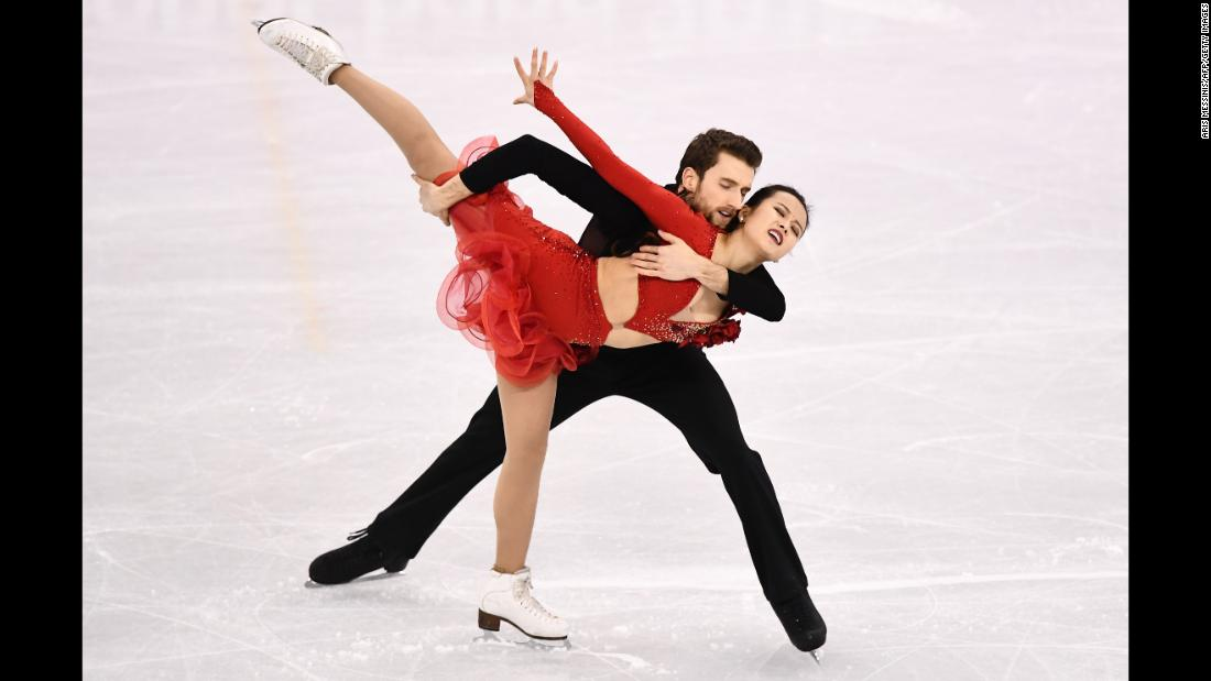 South Korea's Yura Min and Alexander Gamelin skate together in the ice dancing.