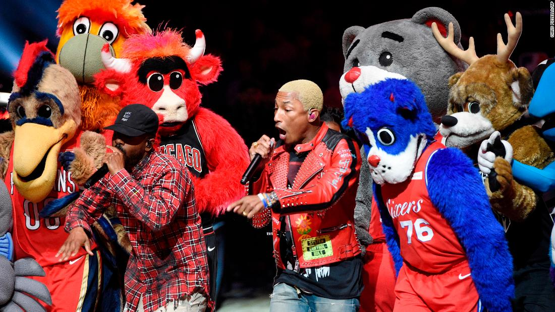 N.E.R.D performs with NBA mascots during the halftime show.