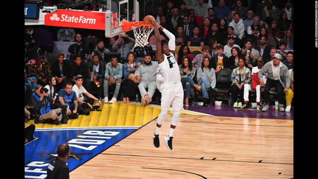 Victor Oladipo throws down a reverse dunk on a breakaway.