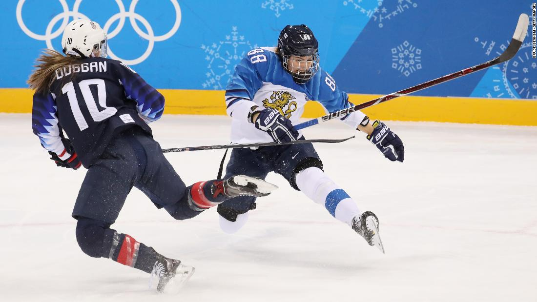 Finland's Ronja Savolainen, right, collides with American Meghan Duggan during their hockey semifinal.