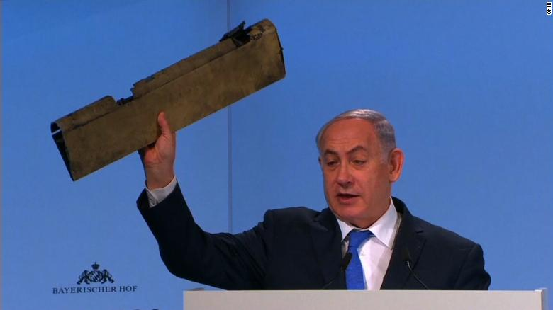 Netanyahu holds piece of drone at conference