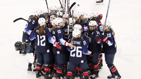 The US women's ice hockey team celebrates its 5-0 win over Finland on February 19.