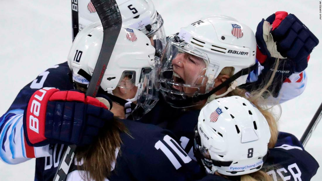 Gigi Marvin, top right, celebrates with her American teammates after scoring the opening goal against Finland. Team USA won 5-0 to advance to the final.
