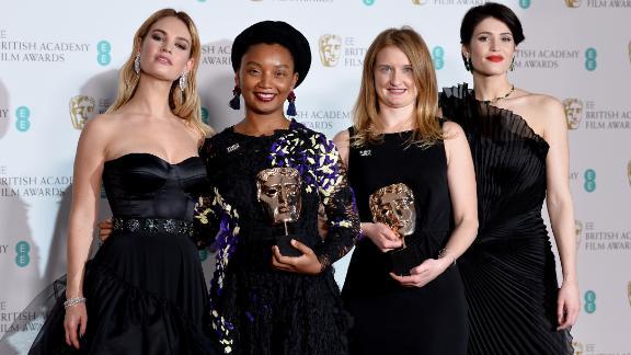 Presenters Lily James (L) and Gemma Arterton (R) and Rungano Nyoni (2ndL) and Emily Morgan (2ndR) at the 2018 BAFTAs.