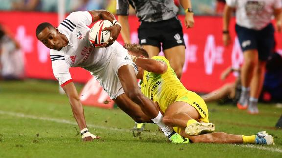 Baker tries to slip through a tackle during the 2018 Sydney Sevens clash between USA and Australia.