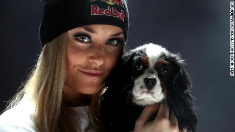 Lindsey Vonn of USA poses with her dog Lucy after a press conference at Hotel Reine Victoria ahead of the FIS Alpine World Ski Championships on February 5, 2017 in St Moritz, Switzerland