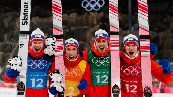 Gold medallists Norway's Daniel Andre Tande, Andreas Stjernen, Johann Andre Forfang and Robert Johansson celebrate during the victory ceremony in the men's large hill team ski jumping final round.