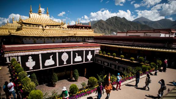Chinese tourists on the roof of the Jokhang Temple in the regional capital Lhasa, in China's Tibet Autonomous Region, in September 2016.