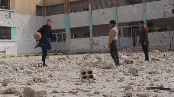 Najem plays soccer with his friends.