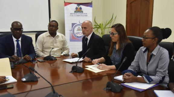 Minister of Planning and External Cooperation Aviol Fleurant, left, speaks during a meeting with Oxfam Regional Director for Latin America and the Caribbean, Simon Ticehurst, center, and Oxfam Intermon Executive Affiliate Unit head, Margalida Massot, second from right, in Port-au-Prince on February 19, 2018.