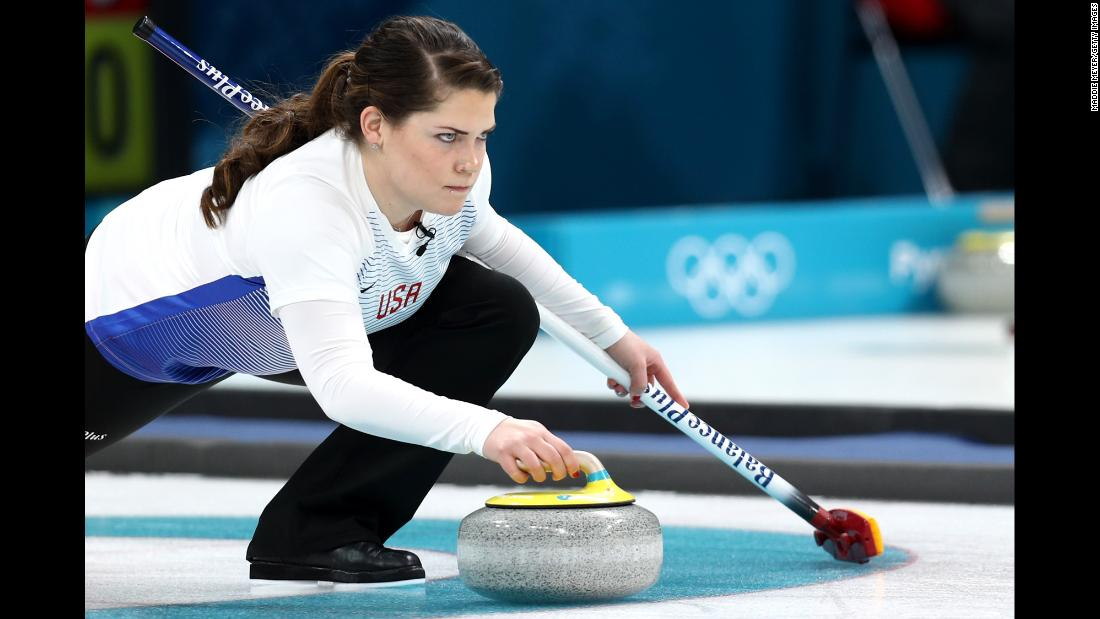 American Becca Hamilton delivers a stone during a round-robin curling match.