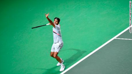 Switzerland's Roger Federer serves to Robin Haase of the Netherlands  during their Rotterdam Open quarter-final.