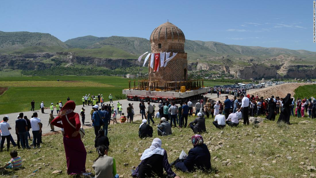 "Locals watch the tomb of Zenyel Bey transported in May 2017. The 15th century monument, dedicated to a figure from the Ak Koyunlu, a Turkmen tribe, was moved away from ground at risk of flooding due to a hydroelectric dam project in southeast Turkey. The Ak Koyunlu, which translates as ""White Sheep,"" once ruled Anatolia, Azerbaijan and northern Iraq in the 14th to early-16th century AD."