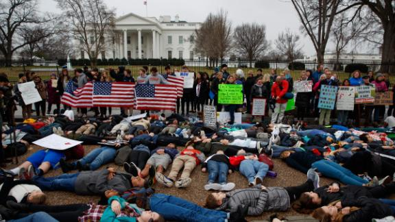 "Demonstrators participate in a ""lie-in"" during a protest in favor of gun control reform in front of the White House, Monday, Feb. 19, 2018, in Washington. (AP Photo/Evan Vucci)"