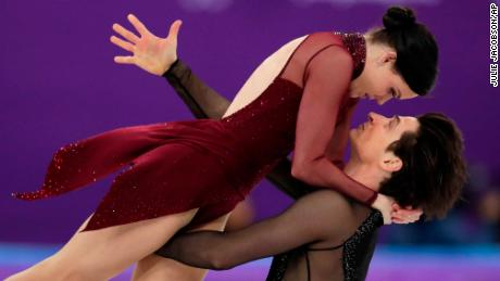 Tessa Virtue and Scott Moir of Canada perform during the ice dance, free dance figure skating final in the Gangneung Ice Arena at the 2018 Winter Olympics.