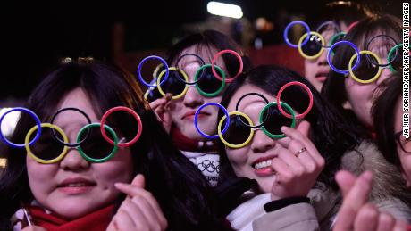 South Korean fans wearing sunglasses shaped like the Olympic rings attend medal ceremonies at the Pyeongchang Medals Plaza.