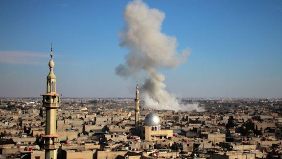 Smoke rises from buildings in Mesraba, Eastern Ghouta, after a bombardment on Monday.