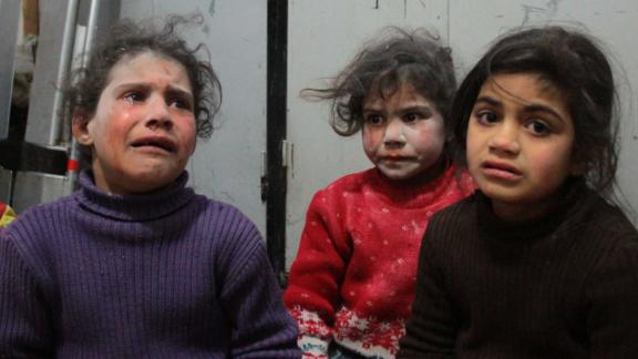 Syrian children cry at a make-shift hospital in Douma following air strikes on the Syrian village of Mesraba in the besieged Eastern Ghouta region on the outskirts of the capital Damascus, on February 19, 2018. Heavy Syrian bombardment killed dozens of civilians in rebel-held Eastern Ghouta, as regime forces appeared to prepare for an imminent ground assault. / AFP PHOTO / Hamza Al-Ajweh        (Photo credit should read HAMZA AL-AJWEH/AFP/Getty Images)