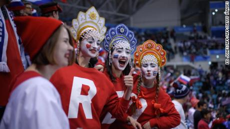 TOPSHOT - Fans cheers before the men's ice hockey preliminary round group B game between the Olympic Athletes from Russia and the United States during the Pyeongchang 2018 Winter Olympic Games at the Gangneung Hockey Centre in Gangneung on February 17, 2018. / AFP PHOTO / Ed JONES        (Photo credit should read ED JONES/AFP/Getty Images)