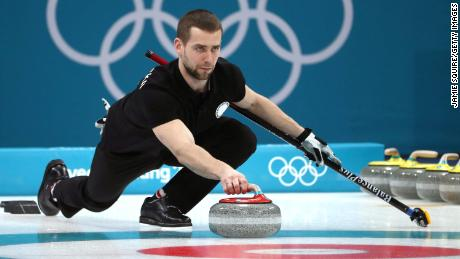 Aleksandr Krushelnitckii of Olympic Athletes from Russia delivers a stone against Norway during the Curling Mixed Doubles Bronze Medal Game.