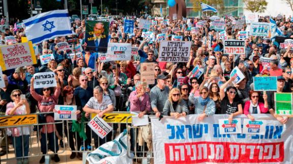 Crowds in Tel Aviv protest against Prime Minister Benjamin Netanyahu.