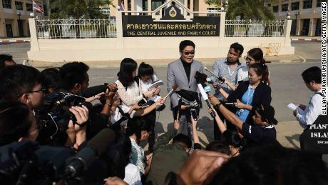 Thai lawyer Kong Suriyamontol speaks to the press after his client was granted paternity rights to his 13 children.