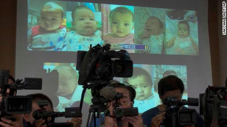 Thai police display projected pictures of surrogate babies born to a Japanese man at a press conference in 2014.