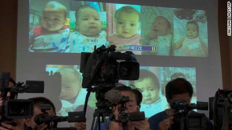 FILE - In this Aug. 12, 2014, file photo, the media attend a press briefing where Thai police display projected pictures of surrogate babies born to a Japanese man who is at the center of a surrogacy scandal during a press conference at the police headquarters in Chonburi, Thailand. Bangkok's Central Juvenile and Family Court on Tuesday gave Mitsutoki Shigeta sole legal custody of the children he fathered using Thai surrogate mothers, ruling that he's financially stable and showed his plans to care for them. (AP Photo/Sakchai Lalit, File)