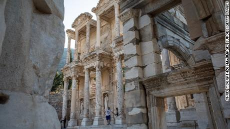 IZMIR, TURKEY - SEPTEMBER 18:  Tourists view the ruins of the Library of Celsus in the ancient city of Ephesus on September 18, 2017 in Izmir, Turkey. The ancient city of Ephesus continues to draw visitors as one of Turkey's top tourist attractions. Ephesus was an Ancient Greek city. Excavations of the site have revealed grand monuments from the Roman Imperial period including the remains of the famous Temple of Artemis, the Great Theatre and the Library of Celsus.  (Photo by Chris McGrath/Getty Images)