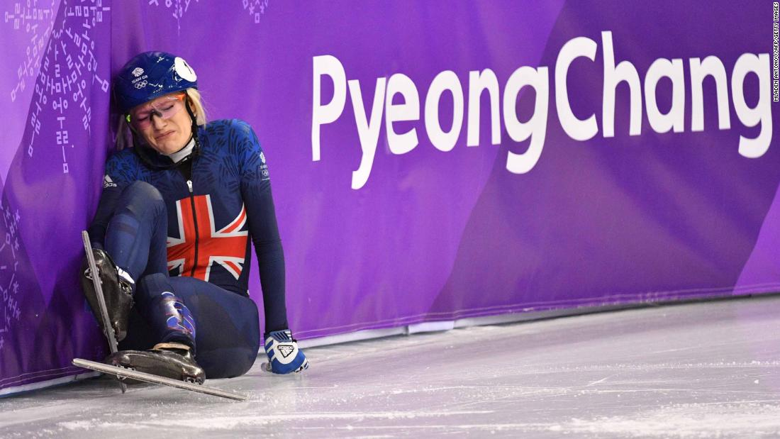 British speedskater Elise Christie falls during a 1,000-meter short-track race.