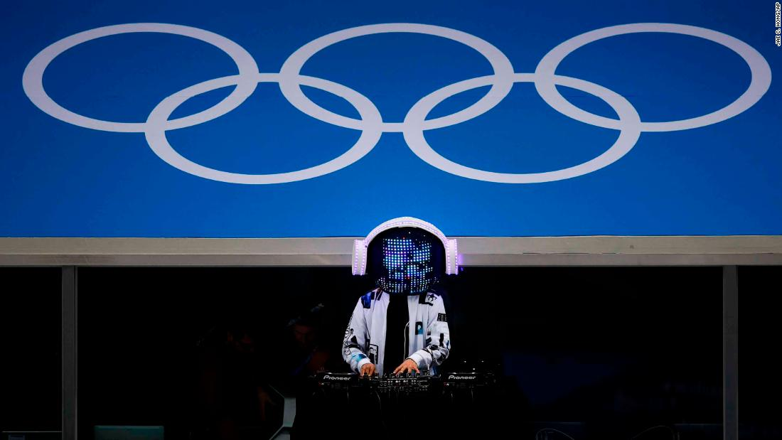 A DJ performs before the men's hockey game between Norway and Slovenia.