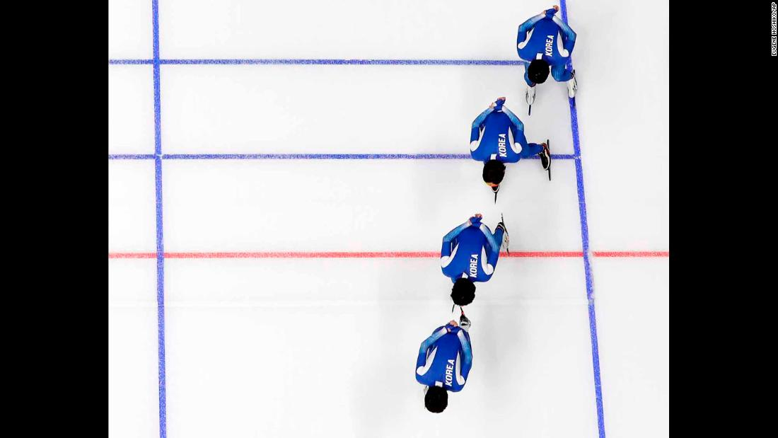 South Korean speedskaters train for a team pursuit race.