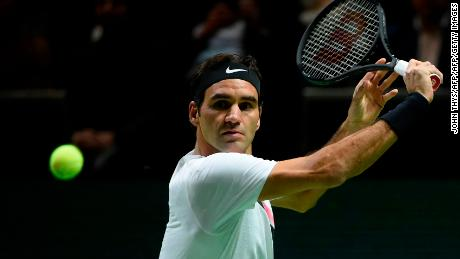 Switzerland's Roger Federer plays a backhand return to Netherlands Robin Haase during their quarter-final singles tennis match for the ABN AMRO World Tennis Tournament in Rotterdam on February 16, 2018.  / AFP PHOTO / JOHN THYS        (Photo credit should read JOHN THYS/AFP/Getty Images)