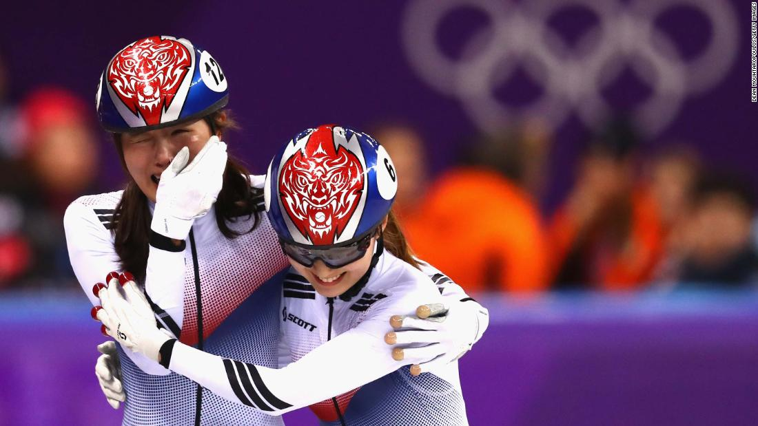 Short-track speedskaters Kim A-lang, left, and Choi Min-jeong celebrate after South Korea won gold in the 3,000-meter relay.