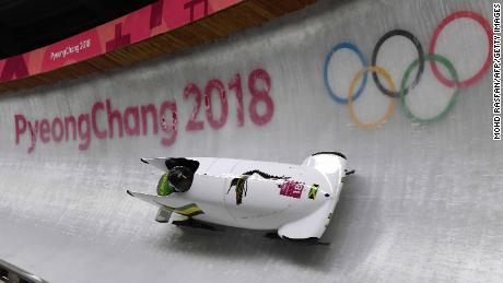 Jamaica's Jazmine Fenlator-Victorian and Jamaica's Carrie Russell compete in the women's bobsleigh heat 1 run during the Pyeongchang 2018 Winter Olympic Games, at the Olympic Sliding Centre on February 20, 2018 in Pyeongchang.  / AFP PHOTO / MOHD RASFAN        (Photo credit should read MOHD RASFAN/AFP/Getty Images)