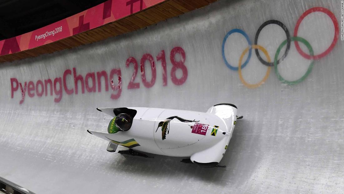 Jamaican bobsledders Jazmine Fenlator-Victorian and Carrie Russell make their first run down the course.