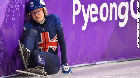 Britain's Elise Christie falls during the women's 1,000m short track speed skating heat event during the Pyeongchang 2018 Winter Olympic Games, at the Gangneung Ice Arena in Gangneung on February 20, 2018. / AFP PHOTO / Mladen ANTONOV        (Photo credit should read MLADEN ANTONOV/AFP/Getty Images)
