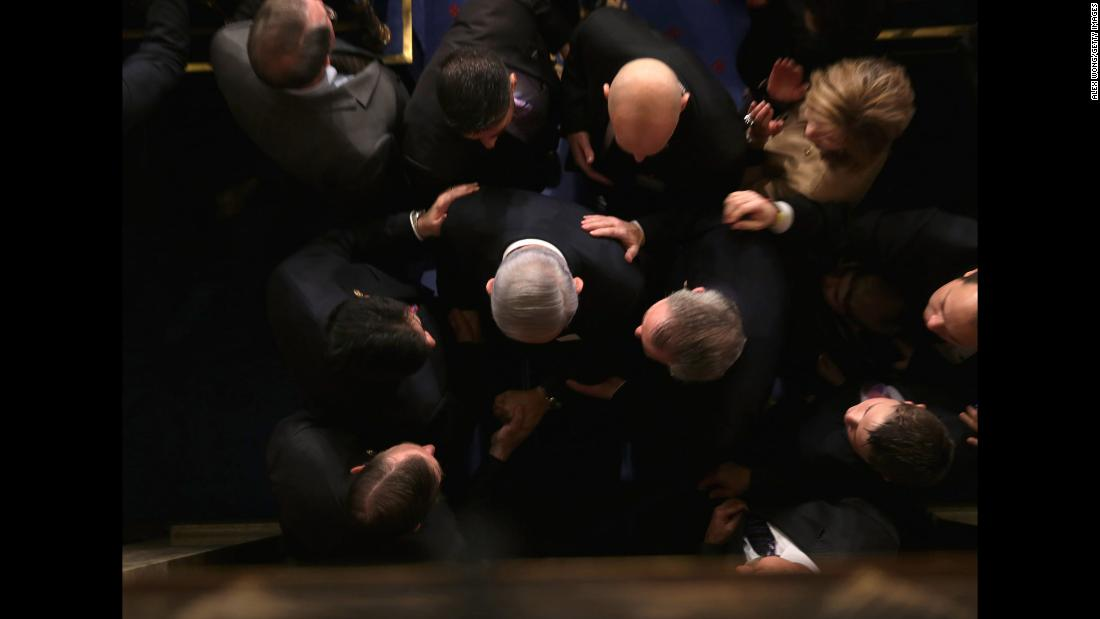 "Netanyahu is greeted by members of US Congress as he arrives to speak in the House chamber in March 2015. He warned that a proposed agreement between world powers and Iran was ""a bad deal"" that would not stop Tehran from getting nuclear weapons -- but would rather pave its way to getting lots of them and leave the Jewish State in grave peril."