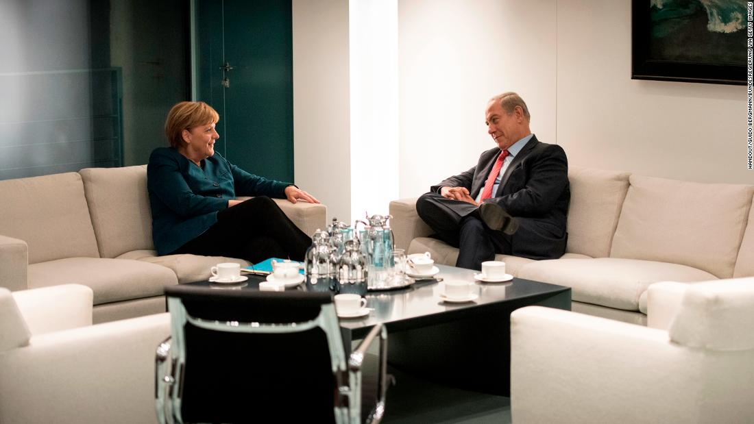 Netanyahu and German Chancellor Angela Merkel talk in Berlin in October 2015.