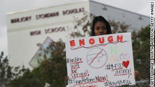 Tyra Heman, a senior at Marjory Stoneman Douglas High School, protests in front of the school where 17 people were killed on February 14.