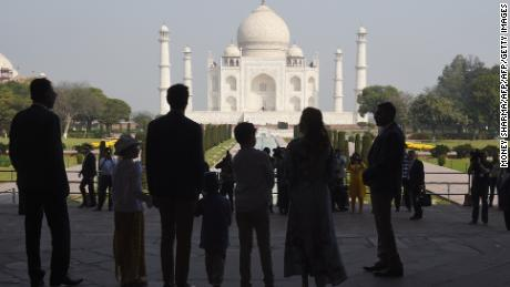The Trudeau family stands silhouetted in front of the Taj Mahal in Agra.