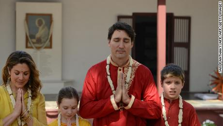 Canadian Prime Minister Justin Trudeau (2nd) with his wife Sophie Gregoire Trudeau (L),  daughter Ella-Grace (2nd L) and son Xavier (R) visit Gandhi Ashram in Ahmedabad on February 19, 2018. The ashram was one of the residences of Indian independence icon Mahatma Gandhi, and was from where he launched his famous 1930 protest march against the British Salt Law. Trudeau and his family are visiting India on a week-long official trip. / AFP PHOTO / SAM PANTHAKY        (Photo credit should read SAM PANTHAKY/AFP/Getty Images)