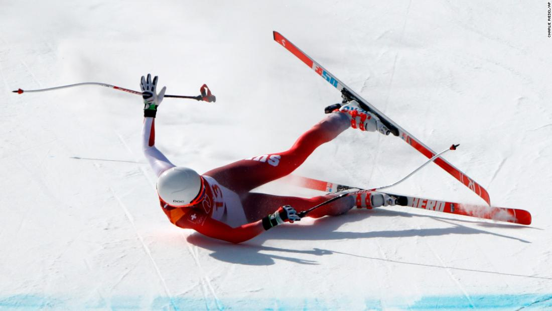 Swiss skier Michelle Gisin crashes at the end of her downhill run.