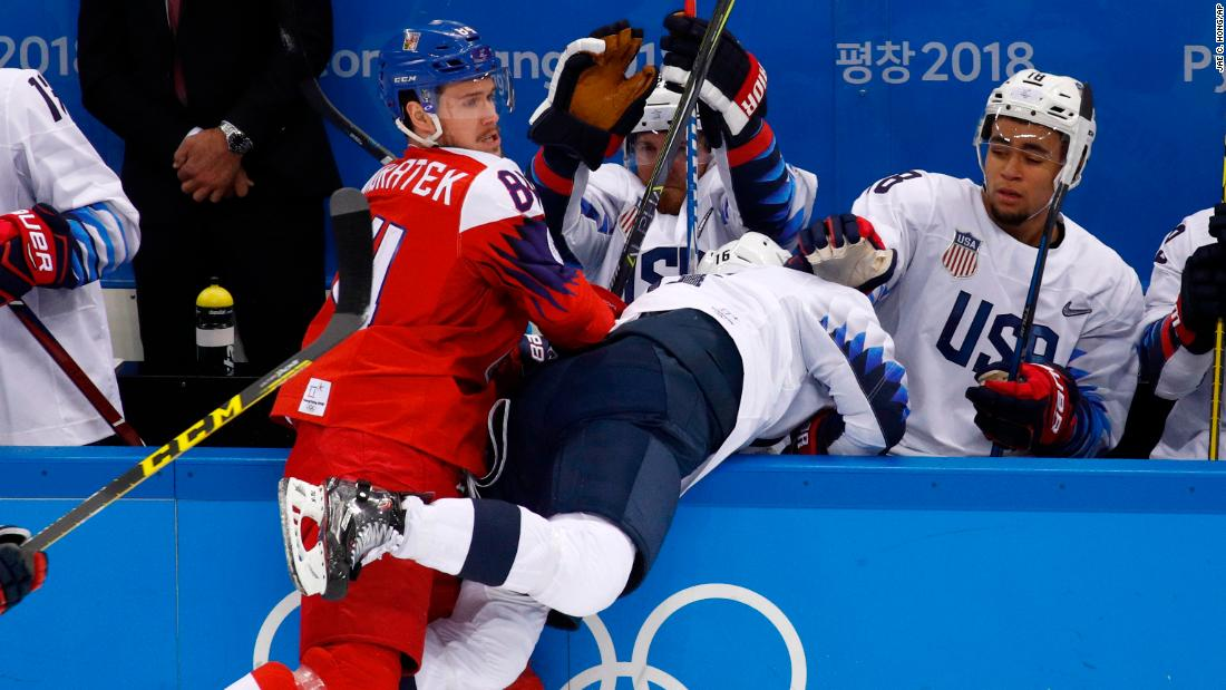 Czech hockey player Tomas Kundratek checks American Ryan Donato during their hockey quarterfinal.
