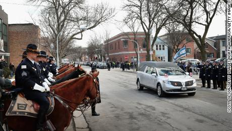 CHICAGO, IL - FEBRUARY 16:  The remains of Police Commander Paul Bauer arrive at the Nativity of Our Lord church in the Bridgeport neighborhood for his wake on February 16, 2018 in Chicago, Illinois. Bauer was shot and killed on February 13, while trying to help stop a man being pursued by tactical officers in the city's downtown. Bauer's funeral is scheduled for tomorrow. Bauer was attached to the mounted unit before his becoming commander of the 18th district.  (Photo by Scott Olson/Getty Images)