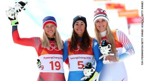 Sofia Goggia (center) celebrates with Ragnhild Mowinckel (left) and Lindsey Vonn (right).