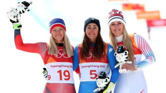 Gold medalist Sofia Goggia, center, of Italy celebrates with silver medalist Ragnhild Mowinckel, left, of Norway and bronze medalist Lindsey Vonn, right, of the United States during the victory ceremony for the Ladies' Downhill.