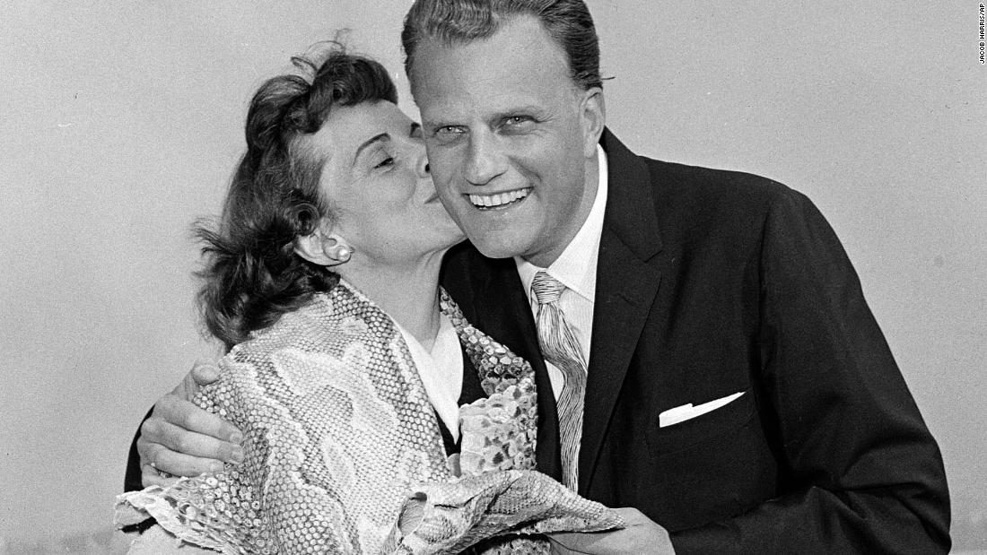 Graham gets a kiss from his wife, Ruth, after they returned to the United States following a tour in Africa and the Middle East.